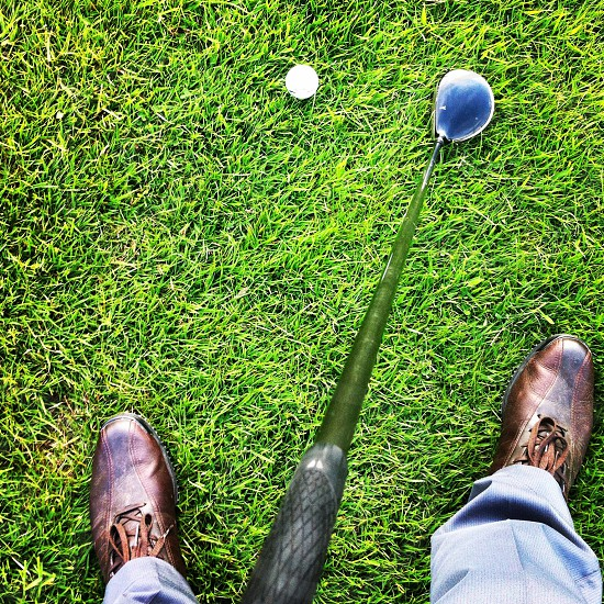 Golf golf club golf ball golf shoes grass sports photo