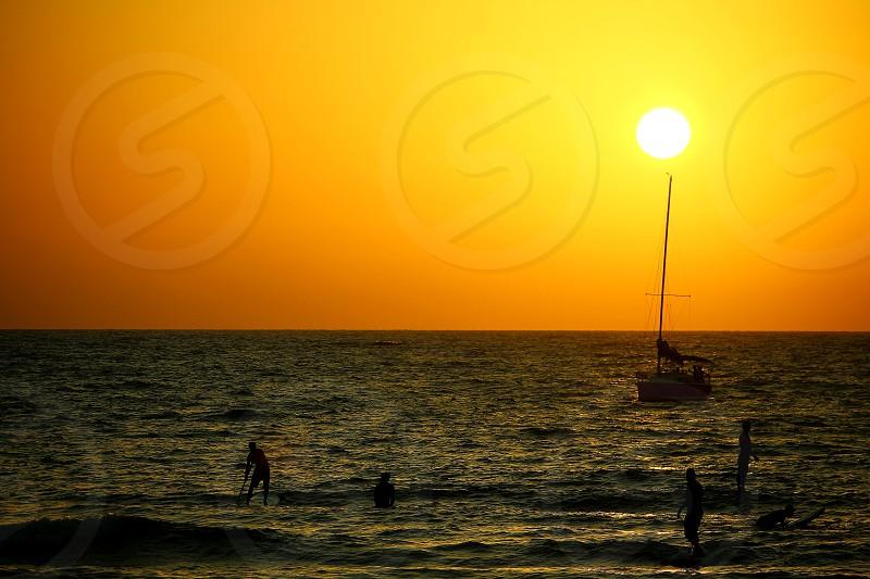 sunrise beach sailing people surfing foam waves ssport summer photo
