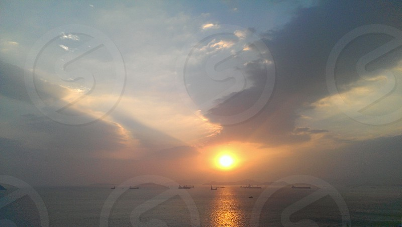 Southern part of Hong Kong Sun goes down from the pacific sea photo