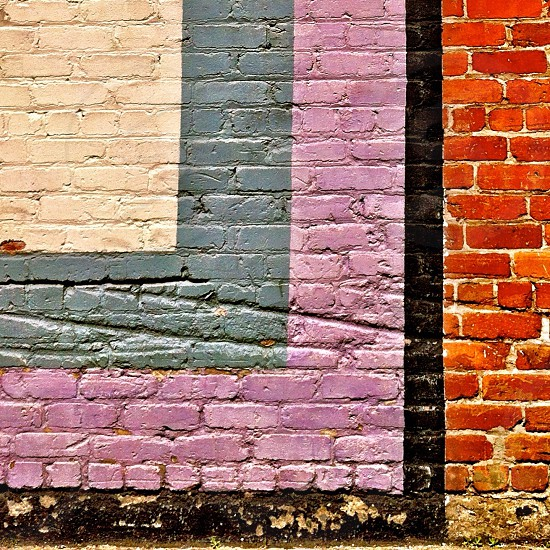 red black purple blue and white bricked wall photo