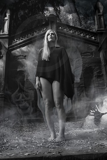 Halloween shoot in a cemetery in the style of the old horror posters photo