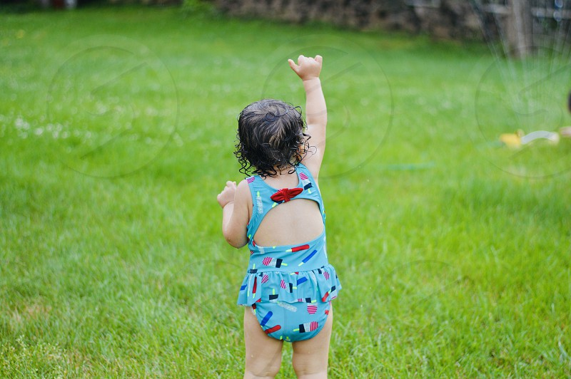 Grass green bathing suit popsicle hair curls hand thumb photo