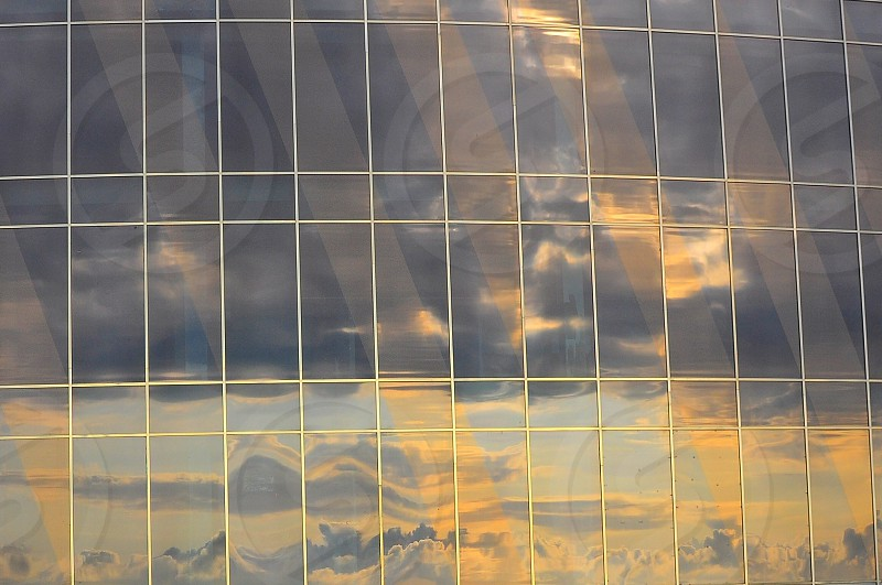 reflection of clouds in building photo