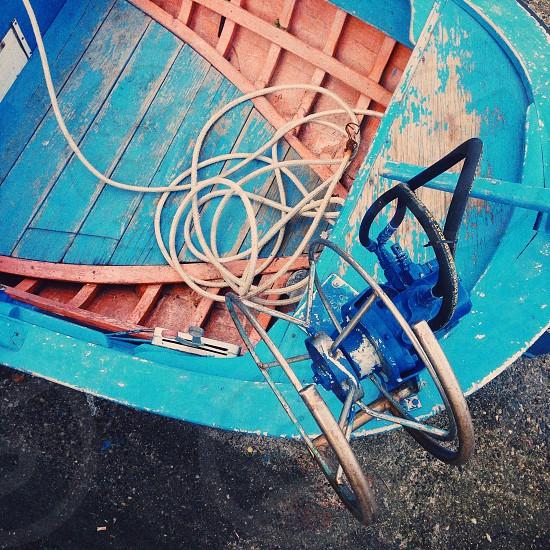 white rope   inside  blue and orange boat  photo