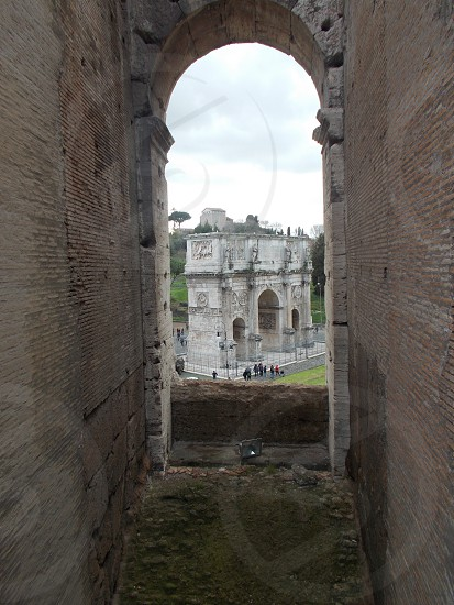 Arch of Constantine outside of the Colosseum in Rome  Italy photo taken inside of the Colosseum photo