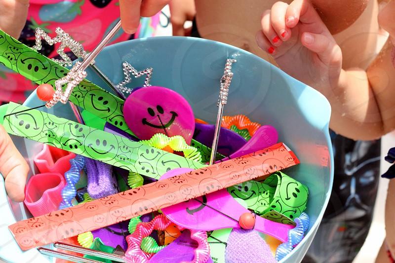 Hands bowl prizes fingers bracelets star green smilie face smile purple bright kids orange shape wand toys photo