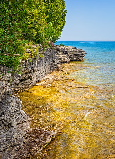 rocky cliff coastline at Door County Wisconsin's Cave Point on the coast of Lake Michigan photo