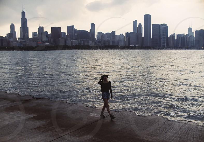 woman walking on seashore photo