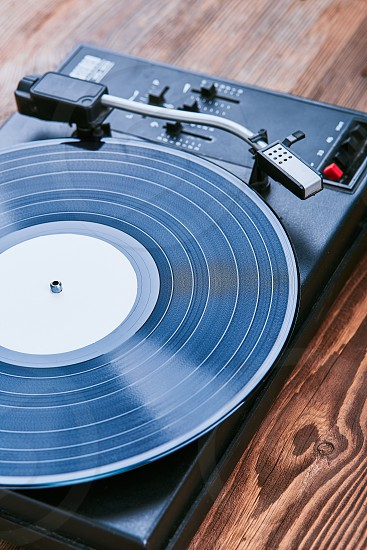 Turntable vinyl player with black vinyl record. Classic stereo set. Candid people real moments authentic situations photo