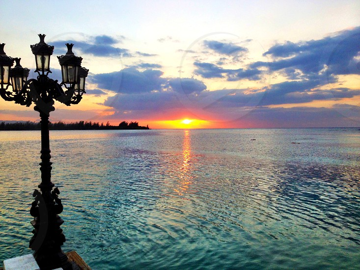 Sunset off the coast of Montego Bay Jamaica photo