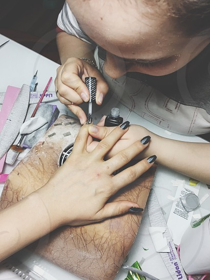 Woman nail artist small business photo