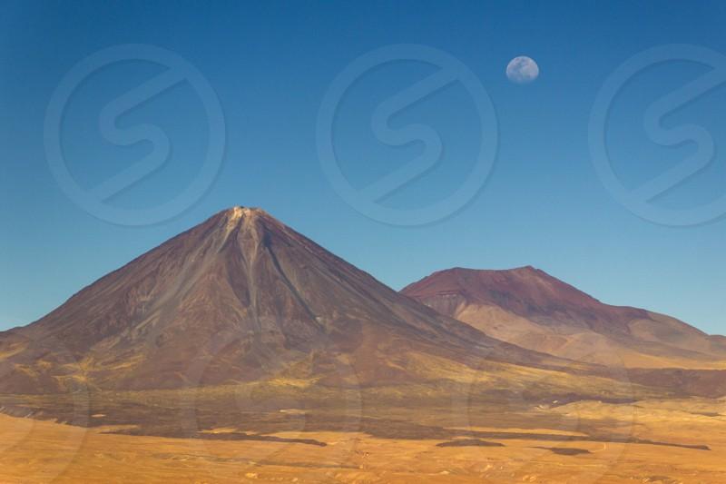 An amazing view of the moon rising up over Licancabur Volcano at Atacama Desert Chile  photo