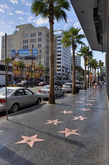 grey sedan parked near hollywood walk of fame photo