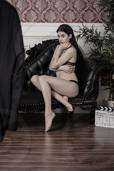 This scene depicts a young female actress being asked to strip by a movie executive the scenario shows the darker side of Hollywood.The term casting couch originated in the motion picture industry with specific references to couches in offices that could be used for sexual activity between casting directors or film producers and aspiring actors. photo