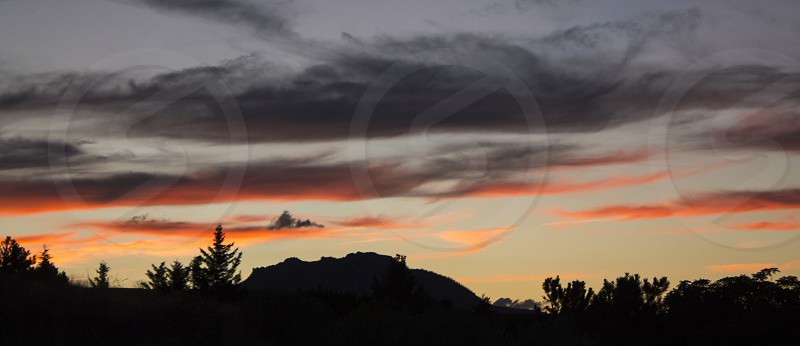 Arizona sunset granite mountain prescott clouds sky amber pink orange vibrant photo