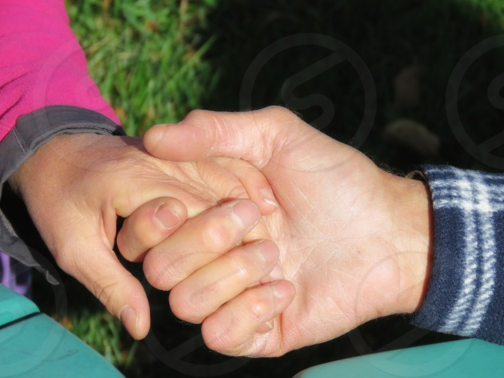 holding hands love plaid cuff pink cuff male hand female hand landscape format summer security forever together peace harmony photo