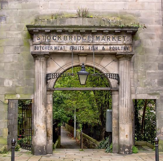 Edinburgh Scotland.  Old historic stone gate to the Stockbridge Market. photo