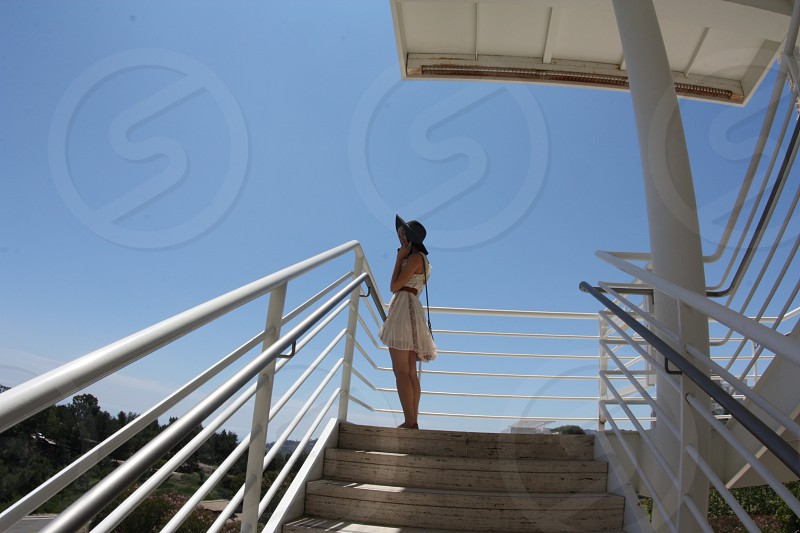 woman standing on a stair photo