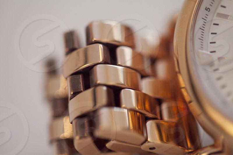 macro photo of gold and white round watch photo
