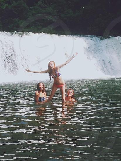 group of girls swimming photo