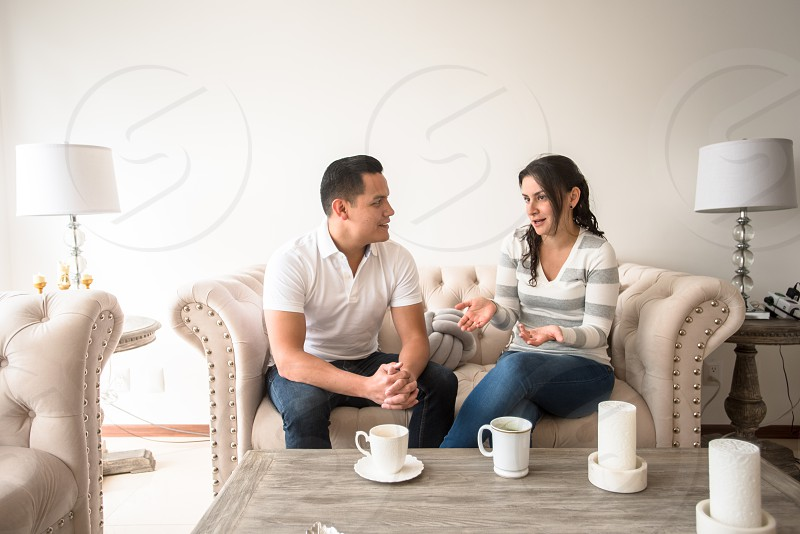 Young copule having breakfast with coffee in their modern apartment  photo