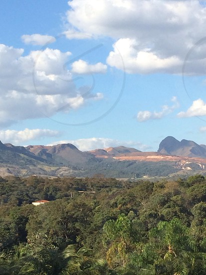 This is a photo taken from a mountain at the Inhotim art park in Brazil.   photo