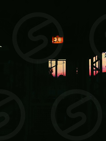 silhouette photo of exit signage photo