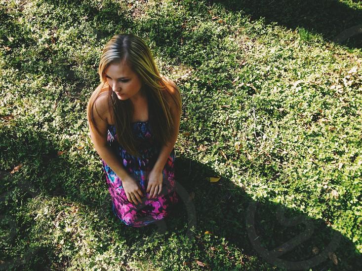 woman kneeling in grass photo