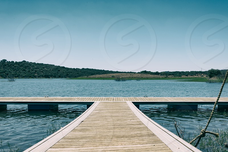 Pier on a storage lake in Portugal (Europe) photo
