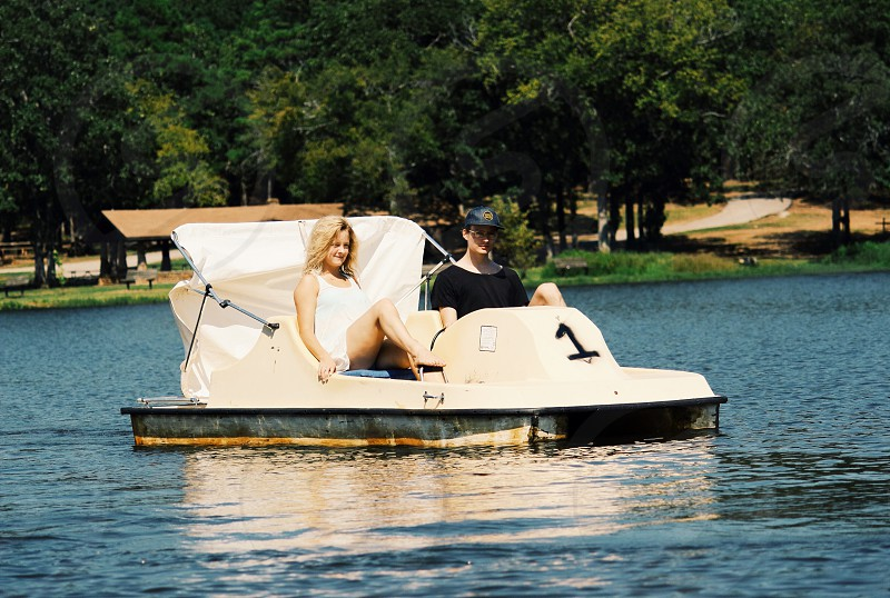couple in a peddling boat photo