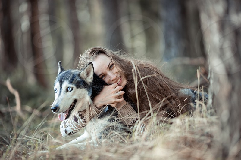 Beautiful young woman portrait with husky dog  photo