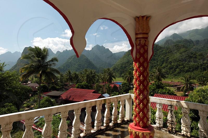 Ein Tempel in der Landschaft bei Vang Vieng in der Bergregion der Nationalstrasse 13 zwischen Vang Vieng und Luang Prabang in Zentrallaos von Laos in Suedostasien.   photo