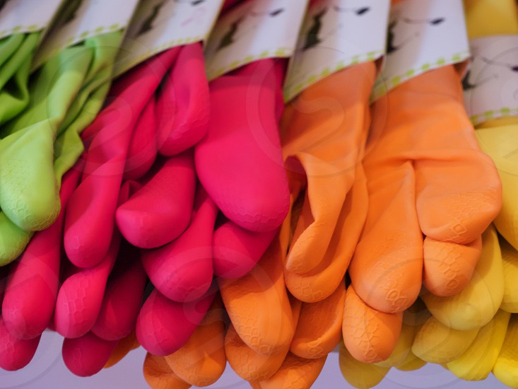 Assortment of colorful rubber gloves photo