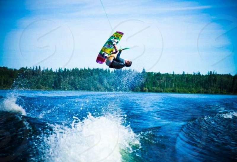 man doing stunt while wakeboarding photo