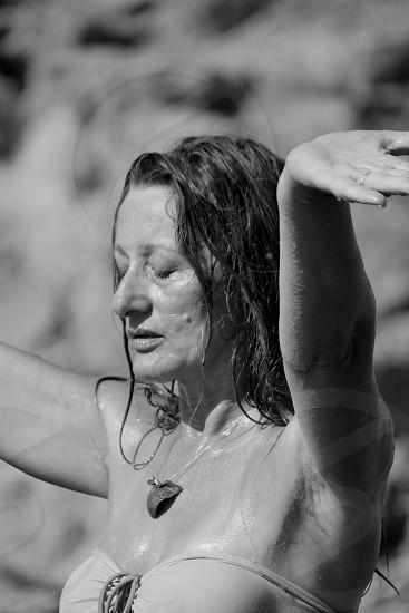 raised arms woman worship celebration meditation photo