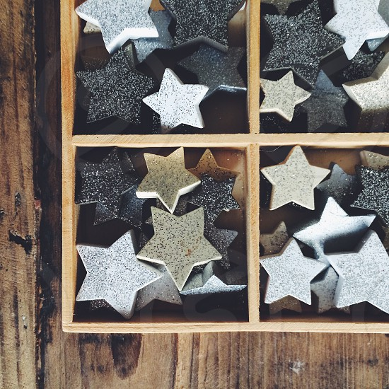 Christmas decorations square box with wooden glittery stars photo