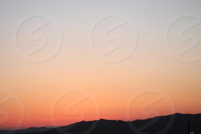 Soft coral sky at dawn photo