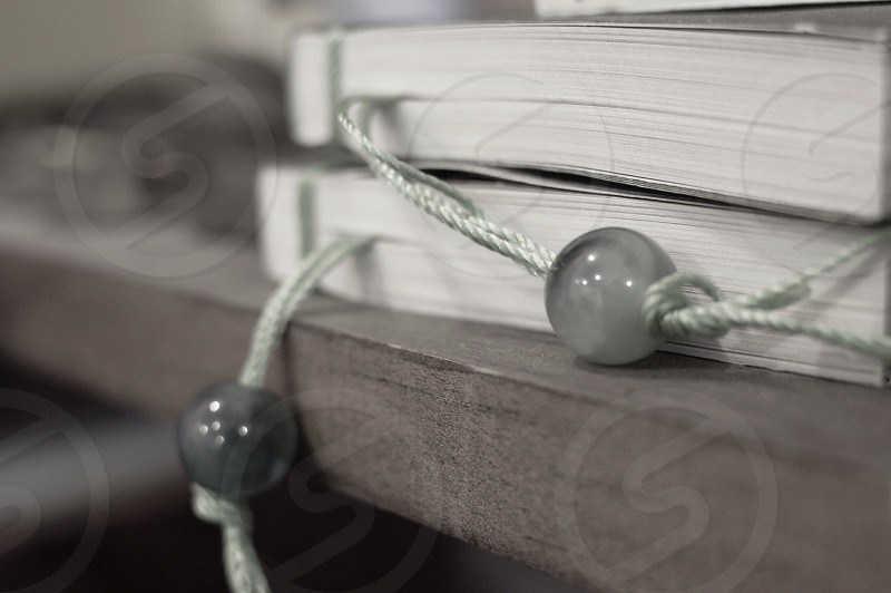 marble beads on string as book marks photo