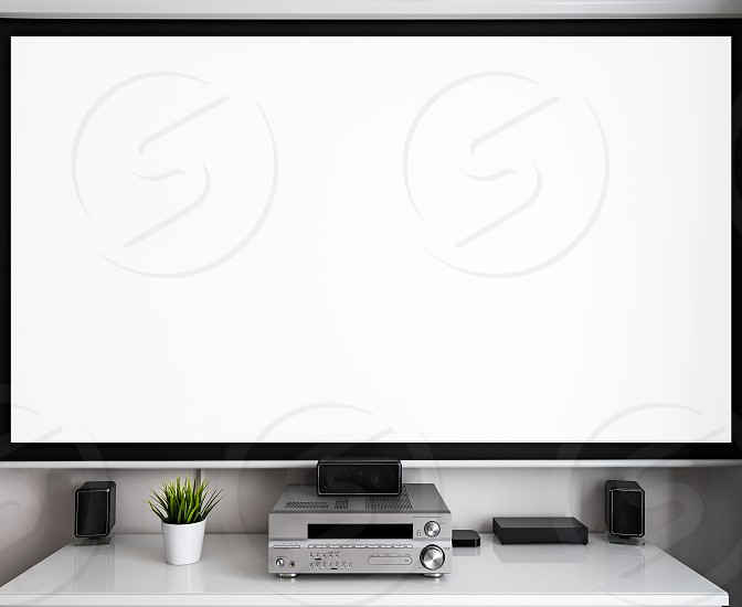 Home multimedia center with wide cinema theater screen in room. Space for text on screen. photo