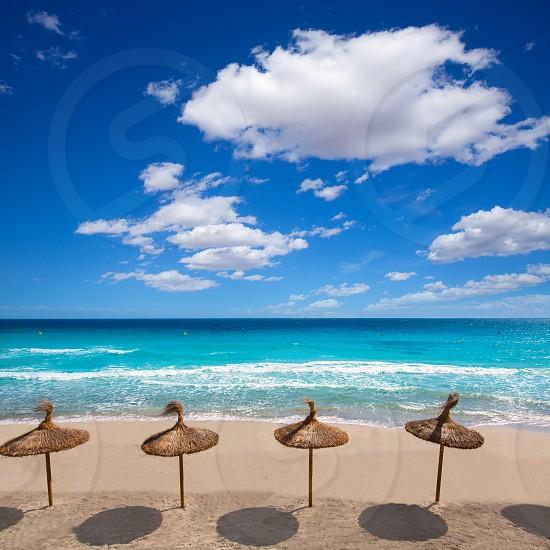 Menorca sunroof row tropical beach at Balearic islands of Spain photo