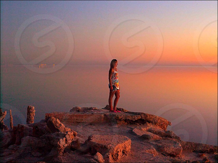 person facing sunset on the sea photo