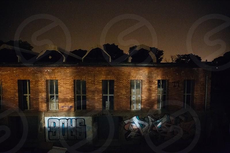 urban exploration abandoned warehouse night photo