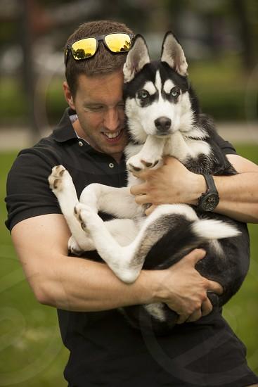 Man with husky puppy photo