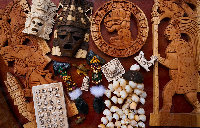 Mayan mexican handcrafts souvenirs carved wood mix photo