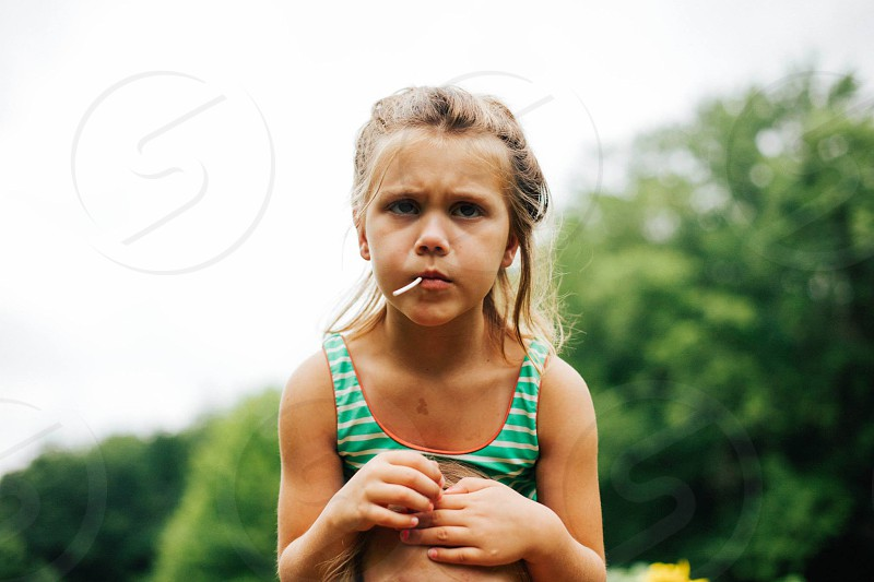 girl little cranky lollipop shoulder ride tan summer photo