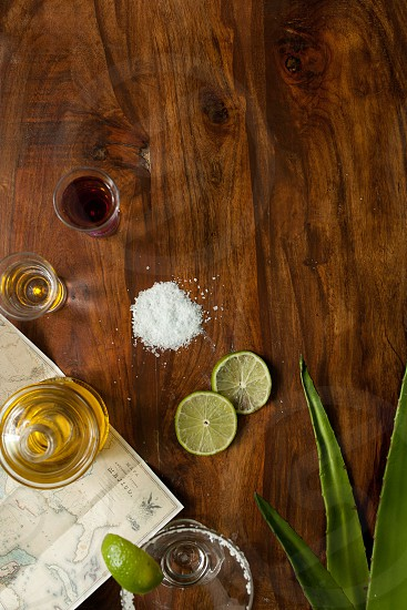 tequila with salt and lemon on brown table photo