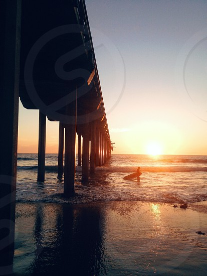black wooden bridge and seashore photo