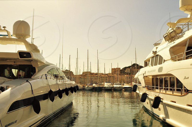 Peering between yachts along the French Riviera photo