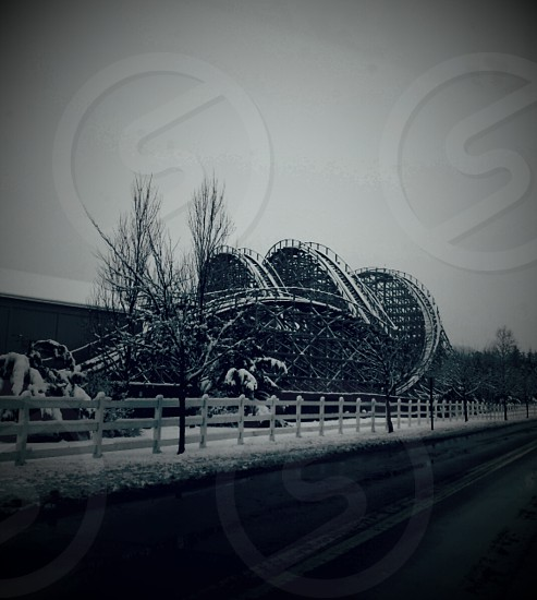 snowy wooden rollercoaster photo
