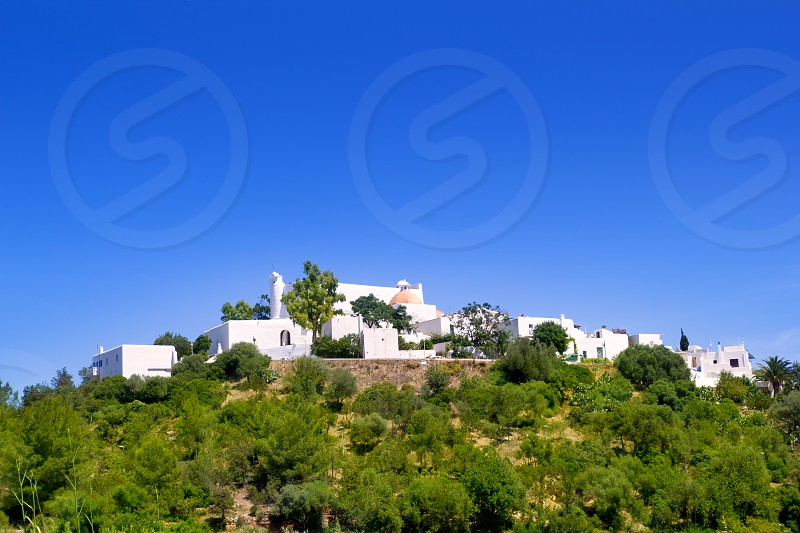 Ibiza Santa Eulalia del Rio hill with white houses photo